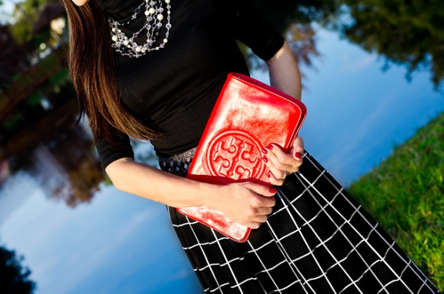 tory-burch-clutch-and-window-pane-midi-skirt