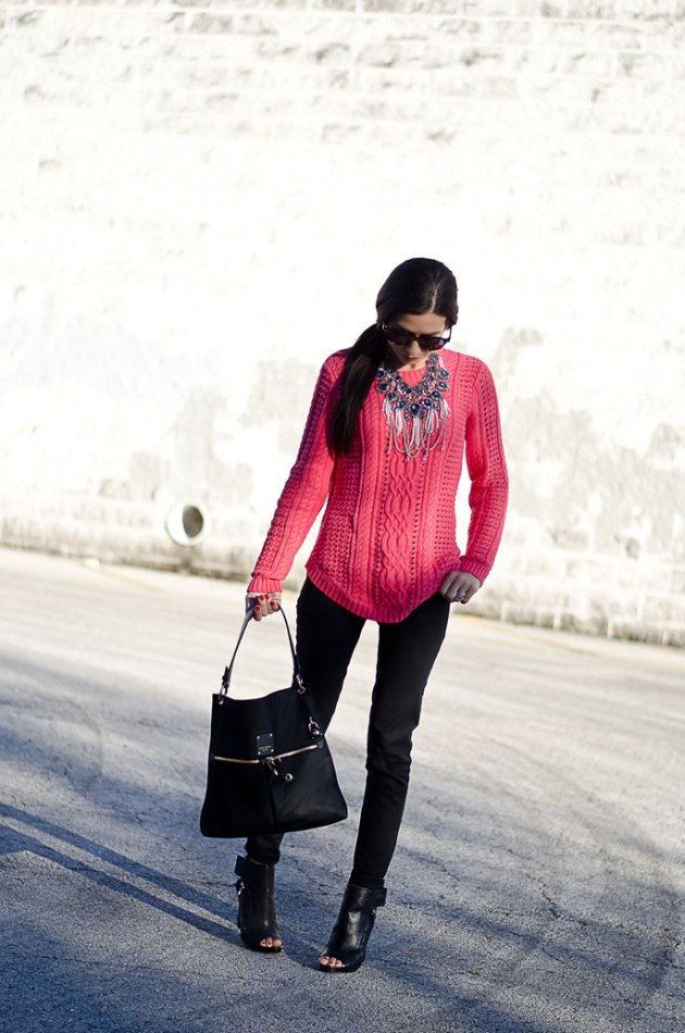 dressing-up-a-bright-pink-cable-knit-sweater-with-a-statement-necklace-1
